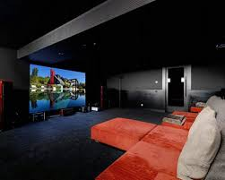 interior cozy black home theater room feature sweet red sofa