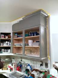 painting kitchen cabinets how many coats of primer how to easily paint kitchen cabinets you will