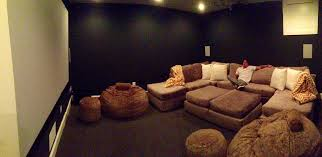 base home theater this home theater has a u shaped sectional with ottomans as well