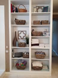 Bathroom Vanity Pull Out Shelves by Domestic Ceo 10 Tips For Organizing Open Bathroom Shelves
