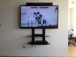 tv mount with shelves double 2 tier wide component shelf installed underneath a 60