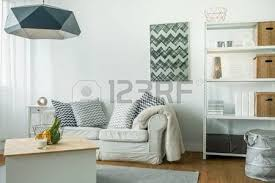 trendy furniture in small cozy living room stock photo picture