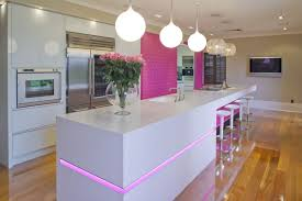 enchanting pink led lights inside sleek kitchen with long white