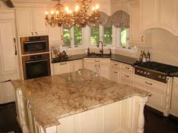 white kitchen cabinets with antique brown granite colossus granite marble inc typhoon bordeaux island