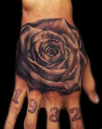 memorial black rose tattoo on hand by carl grace