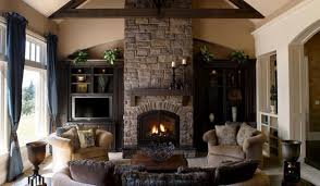 modern living room with stone fireplace green fabric couch tan