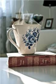 a beautiful cup of coffee and delicious biscuits coffe mugs