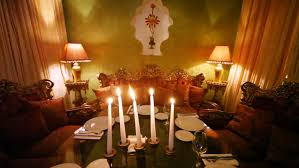 Subjects Of Interior Designing Burning Candle Stands On Decorated Table Among Subjects Of East