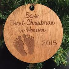 cursive baby u0027s first christmas ornament laser engraved with a
