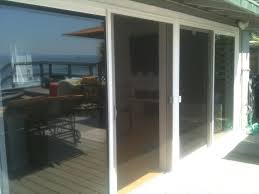 Sliding Door Exterior White Stained Wooden Frame 4 Glass Sliding Patio Door Panel Placed