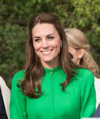 kate middleton sports sneakers and a messy bun following a charity