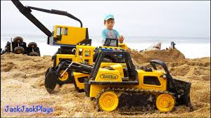 construction toys for kids in action at the beach big tonka truck