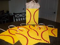 i decorated these 12 goody bags to look like softballs they will