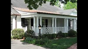front porch and exterior facade makeover with curved copper roof