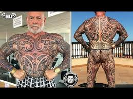 bodybuilder spends 7000 getting his entire body tattooed in just