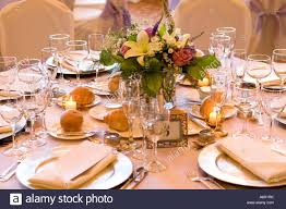 formal wedding table setup with floral centerpiece copyright