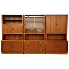 home theater unit furniture set of three danish teak wall unit bookcase shelving by dyrlund at