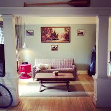 white sofas table twin black wall television studio apartment
