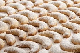 fresh vanilla cookies with powdered sugar for christmas stock