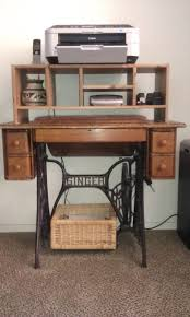Singer Sewing Machine With Cabinet by Old Singer Sewing Machine Cabinet Used As A Printer Stand Office