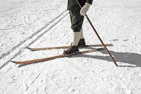old wooden skis and leather ski boots stock photo picture and