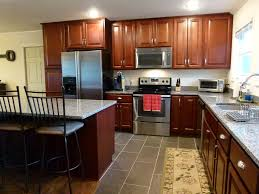wolf classic cabinets in saginaw crimson designed by dennis maurer