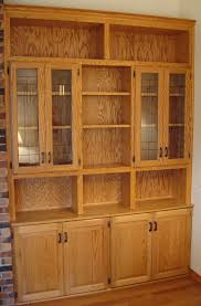 built in oak china cabinet with stained glass doors rugged cross