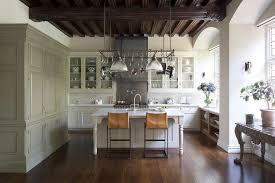 large pot rack over island transitional kitchen