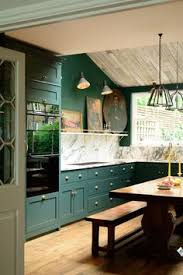 Green Kitchens Hunter Green Kitchen Cabinets With A Brass Sink Faucet Pendant