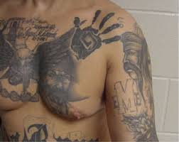 mexican mafia la eme tattoos on the chest and arm gang related