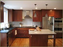 Painting Kitchen Cabinets Without Sanding by Painting Over Stained Cabinets In The Kitchen