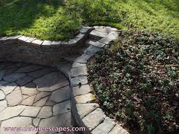 flowing stone wall and patio landscape sculpture in philadelphia