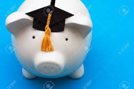 graduation piggy bank piggy bank with graduation cap on blue background saving for