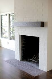 white fireplace whitewashed mantle gather around the fire