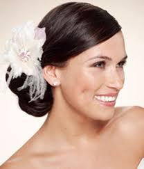 flower hair bun side bun updos hairstyles with flower hair accessory