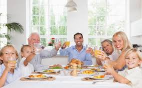 happy family toasting at thanksgiving dinner stock photo