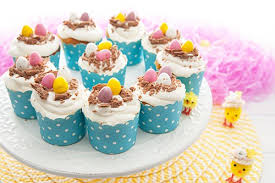 Decorating Easter Egg Cupcakes by The Cutest Easter Egg Cupcakes Gourmet Getaways