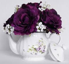 teapot silk flower arrangement deep purple roses white floral