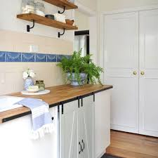 barn door for kitchen cabinets 11 ways to decorate with barn doors