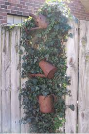 Outdoor Fence Decor Ideas by Outdoor Garden Design With Vines And Ornaments Used Goods Attached