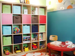 great looking kids room design with round shape red table and