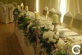 wedding flowers ta top table flower garland and pillar candles the bowdon rooms