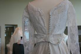 exhibit wedding dresses 81 button back dress close up