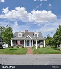 front yard modern minimalist open house design with green grass