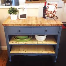 repurposed antique dresser as a kitchen island with a butcher