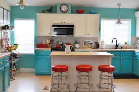 cabinets storages cream tile kitchen island blue kitchen cream tile kitchen island blue kitchen cabinet microwaves open shelves pendant light red barstool black sink faucets wooden floor marble countertops tile