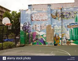 street art graffiti painted on wall next to outdoor basketball