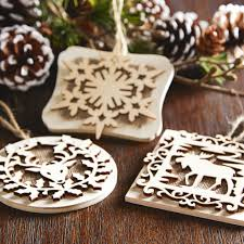 make these snowflake wood ornaments with laser cut