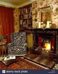 Leopard Chairs Living Room Tiger Print Wing Chair And Leopard Print Stool Beside Fireplace In