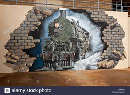 mural broken hill australia stock photos mural broken hill large and spectacular mural of historic steam train smashing through brick wall of building in outback